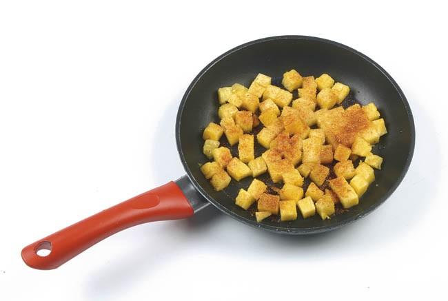 Ensalada de rúcula, frutas y jamón de pato