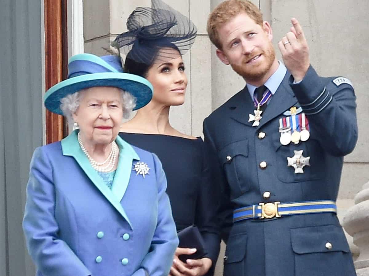 La Reina Isabel Ii, el príncipe Harry y Meghan Markle