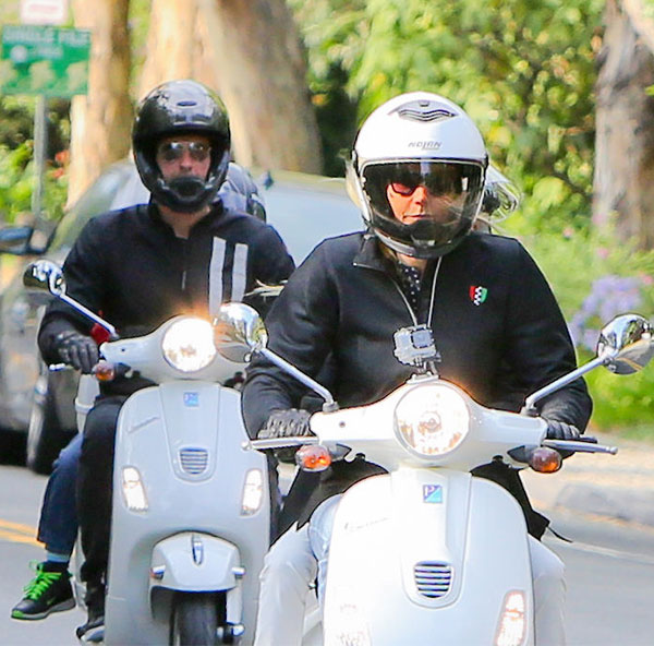 Actress Gwyneth Paltrow and singer Chris Martin take their kids Apple and Moses on Vespas for a ride in Brentwood May 22, 2014