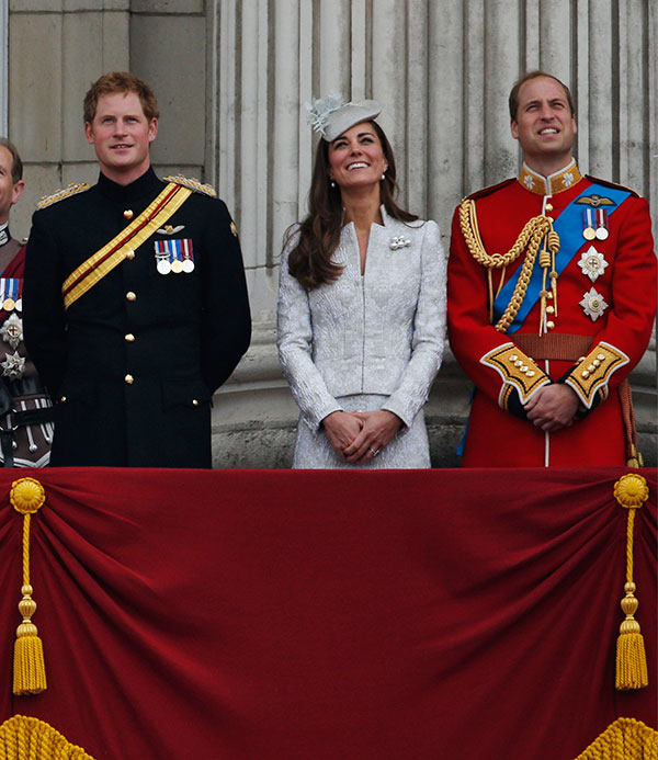 Britain's Prince Harry, centre, reacts with from left, Queen Elizabeth II, Prince Philip, Kate, Duchess of Cambridge and Prince William, as they appear on the balcony of Buckingham Palace, during the Trooping The Colour parade, in central London, Saturday, June 14, 2014.