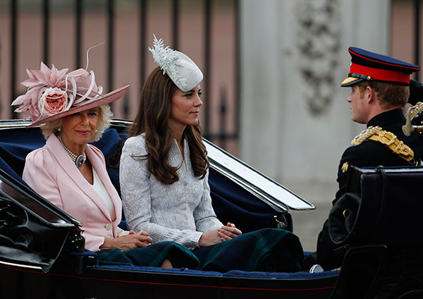 Britain's Kate, Duchess of Cambridge, right, leaves in a horse drawn carriage to attend the Trooping the Colour parade, in central London, Saturday, June 14, 2014.