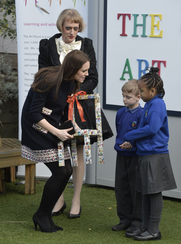 Britain's Kate, Duchess of Cambridge, arrives at a primary school in London, Thursday, Jan. 15, 2015. The Duchess, Royal Patron of The Art Room organization, officially named The Clore Art Room at the school.