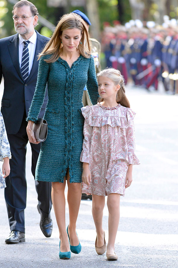 Queen Letizia and Princess Leonor of Borbon attending a military parade, during the known as Dia de la Hispanidad, Spain's National Day, in Madrid, Spain, Sunday, Oct. 12, 2014.