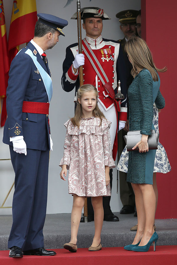 King Felipe VI, Queen Letizia and  Princess Leonor of Borbon attending a military parade, during the known as Dia de la Hispanidad, Spain's National Day, in Madrid, Spain, Sunday, Oct. 12, 2014.