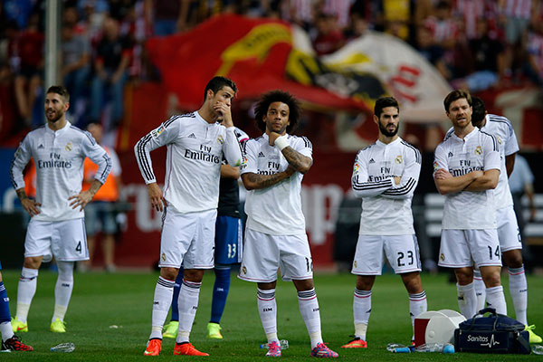 From left: Real Madrid Sergio Ramos, Cristiano Ronaldo, Marcelo from Brazil, Isco, and Xabi Alonso react after loosing the Spanish Super Cup soccer match against Atletico Madrid at the Vicente Calderon stadium in Madrid, Spain, Friday, Aug. 22, 2014 .