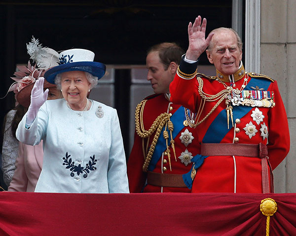 Britain's Queen Elizabeth II, leaves in a horse drawn carriage to attend the Trooping the Colour parade, in central London, Saturday, June 14, 2014.